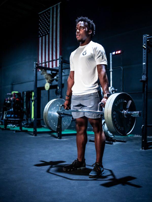 Male G6 Athlete in White Original Tee Deadlifting